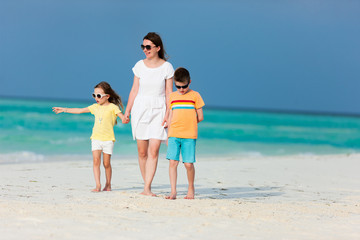 Mother and kids on a tropical beach
