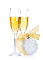 Two champagne glasses and christmas decor