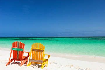 Colorful adirondack lounge chairs at Caribbean beach