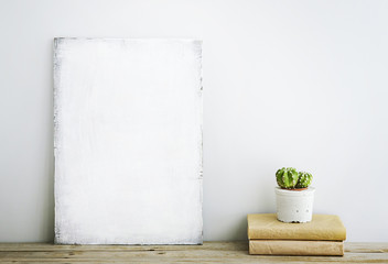 Scandinavian style home decoration.poster with cactus, books