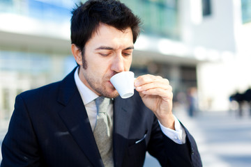 Handsome businessman drinking coffee for breakfast