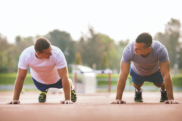 Two young athletes doing push-ups