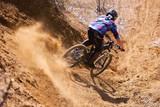 Mountainbiker rides in gorge on desert