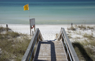 Yellow hazard flag flying on beach