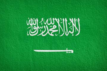 Flag of Saudi Arabia painted onto a grunge wall