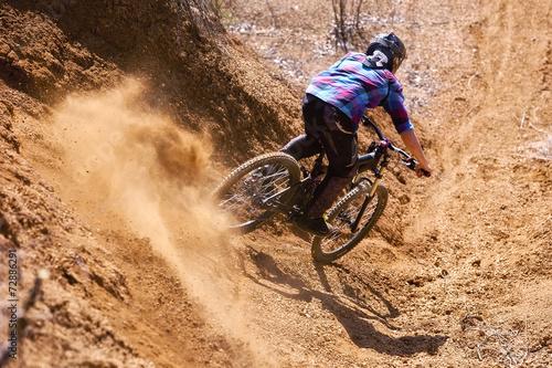 Fotobehang Wielersport Mountainbiker rides in gorge on desert