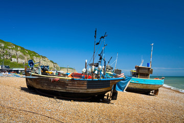 Fishing boats on the beach in Hastings harbour, East Sussex, UK.