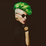 lady with fashionable haircut Colored hair on a black background