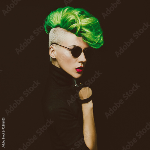 lady with fashionable haircut Colored hair on a black background - 72886823