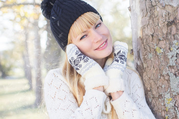 Attractive blonde girl with wearing warm clothes