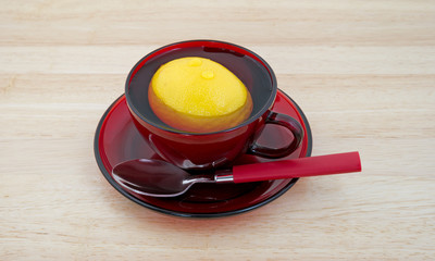 Lemon in cup with water
