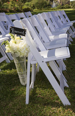 Flower display at end of reserved white seats