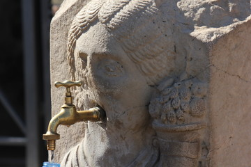 2000 years old ancient face-shaped fountain