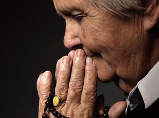 Praying senior woman.