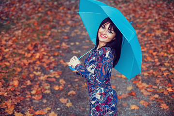 Beautiful woman with blue umbrella