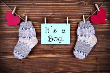 Label with It's a Boy and Baby Stockings on a Line