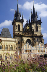 Old town square in Prague. Tyn Cathedral and monument of Jan Hus