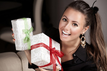 Young happy woman with a gifts