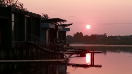 Sunrise over the river near the houses
