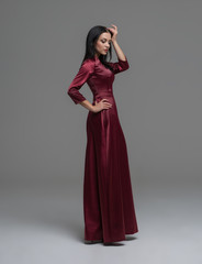 Full-length portrait of a sexy woman in elegant dress