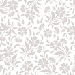 Seamless pattern with beige flowers on a white background.