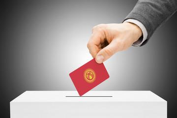 Male inserting flag into ballot box - Kyrgyzstan