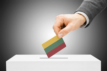 Voting concept - Male inserting flag into ballot box - Lithuania