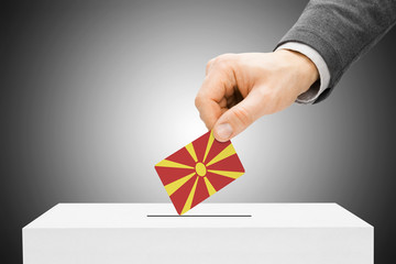 Male inserting flag into ballot box - Republic of Macedonia