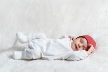 baby sleeping on white