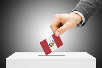 Voting concept - Male inserting flag into ballot box - Peru