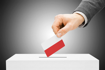 Voting concept - Male inserting flag into ballot box - Poland