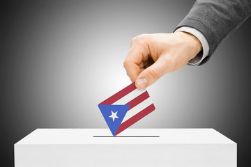 Male inserting flag into ballot box - Puerto Rico