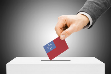 Voting concept - Male inserting flag into ballot box - Samoa