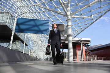Business man travel work look the sign board walking with luggag