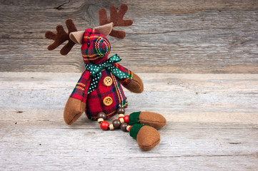 Christmas reindeer toy on wooden background
