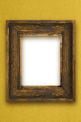 classic old wooden picture frame carved by hand on gold wallpape