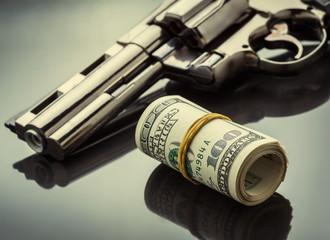 Gun and money concept