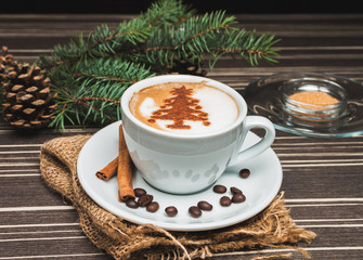 Christmas cup of cappuccino with cinnamon