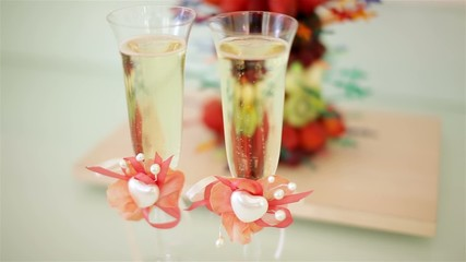 Decorated wineglasses of champagne wedding style