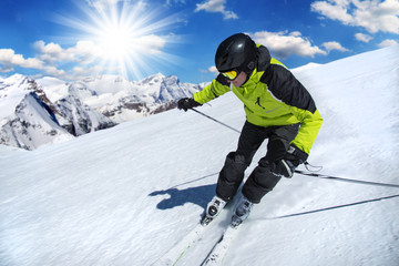 Skier in high mountains