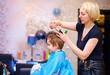 little client, boy having haircut at hair salon