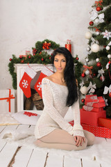 young brunette woman in christmas interior