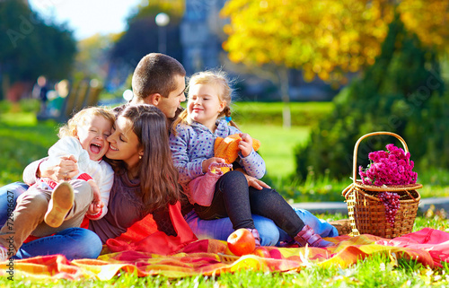 happy family on autumn picnic in park - 72896627