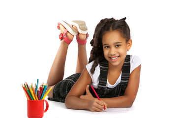 cheerful girl draws pencil lying on the floor