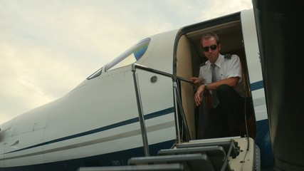 Pilot Unlatches Door and Exits Jet Airplane