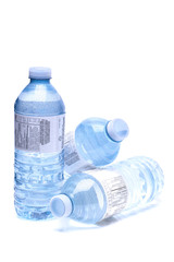 Bottled water close up shot isolated on the white background, sh