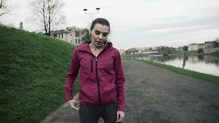 Tired woman resting after jogging in city, super slow motion, 24