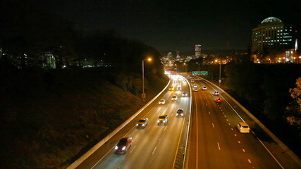 Traffic on I-84 Banfield Freeway with Portland Skyline at Night