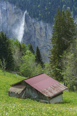Hut and waterfall in Lauterbrunnen, Switzerland.