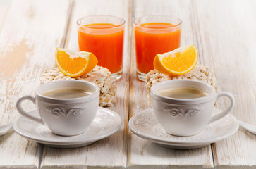 Healthy breakfast - two cup of coffee, orange juice